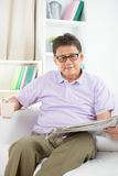 Asian Senior Man Reading Stock Photos