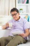 Asian Senior Man Reading Royalty Free Stock Images
