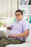 Asian Senior Man Reading Stock Photo