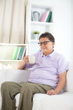Asian Senior Man Reading Royalty Free Stock Photo