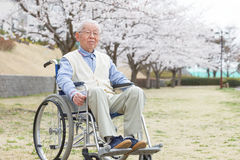 Asian senior man sitting on a wheelchair Stock Photography