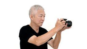 Asian senior man start photography as hobby on free time white i Royalty Free Stock Image