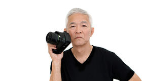 Asian senior man start on photography as hobby on free time Stock Images