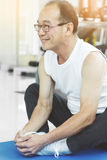 Asian senior man Stretching before workout. At the gym. copy space Royalty Free Stock Photography
