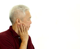 Asian senior man thinking unhappy with copy space Stock Images
