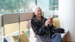 Asian senior man using smart phone. Communicate through technology stock images
