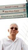 Asian senior man visiting Wat Phra Kaeo,  Sanam Luang landmark B Stock Photography