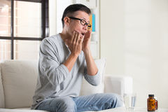 Asian senior with mouth pain Stock Photo