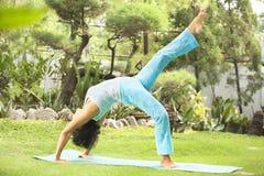 Asian senior old woman doing yoga Stock Photography