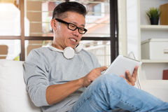 Asian senior relaxing Stock Photo