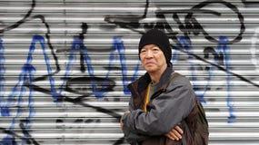 Asian senior traveler with urban grung graffiti background textu Stock Photography