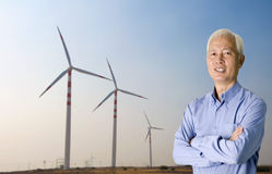 Asian senior with windmill o Stock Photo
