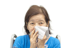 Asian senior woman blowing her nose. With an handkerchief Stock Photos