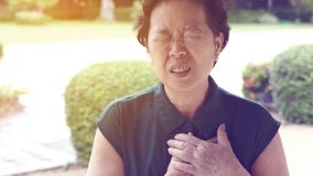 Asian senior woman chest pain heart attack stroke health care stock images