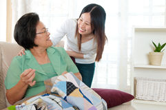 Asian senior woman and daughter Stock Images