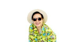 Asian senior woman on green hawaii shirt wear hat and sunglasses Royalty Free Stock Photography