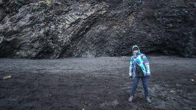 Asian senior woman drean trip travel to Icealand, black beach Stock Photo