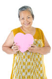 Asian Senior woman holding a gift box Stock Photos