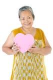 Asian Senior woman holding a gift box stock photos