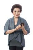 Asian senior woman isolated on white Stock Photography