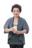 Asian senior woman isolated on white. Portrait of Asian senior woman isolated on white Royalty Free Stock Photos