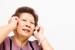 Asian Senior woman listening to music Stock Photography