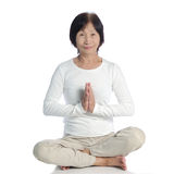 Asian senior woman meditating for yoga Stock Photos