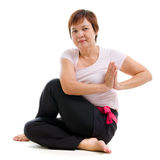 Asian senior woman practicing yoga Stock Photography