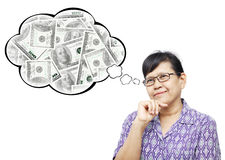 Asian senior woman smilingly and thinking to money. Thinking Asia woman looking up on bubble of money stack stock photo