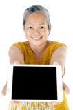 Asian senior woman with tablet Stock Photos
