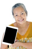 Asian senior woman with tablet Stock Image