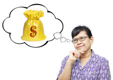 Asian senior woman thinking to money Royalty Free Stock Photos