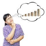 Asian senior woman thinking to money Stock Image