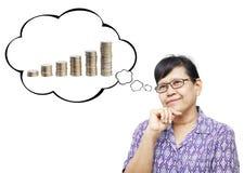 Asian senior woman thinking to money Stock Photo