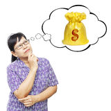 Asian senior woman thinking to money bag. Thinking Asia woman looking up on thought bubble of money bag royalty free stock photo