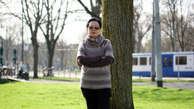 Asian senior woman travel in europe taking portrait in park Royalty Free Stock Photos