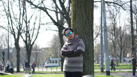 Asian senior woman travel in europe taking portrait in park Royalty Free Stock Images
