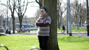 Asian senior woman travel in europe taking portrait in park Royalty Free Stock Image