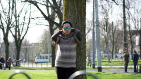 Asian senior woman travel in europe taking portrait in park Stock Images