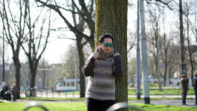 Asian senior woman travel in europe taking portrait in park Royalty Free Stock Photo