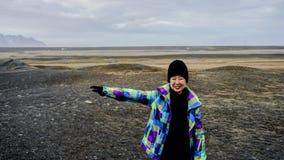 Asian senior woman travel to Iceland have fun retirement Royalty Free Stock Photo