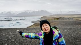 Asian senior woman travel to Iceland have fun retirement. Asian senior woman travel to Iceland have fun after retirement Royalty Free Stock Photos