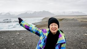 Asian senior woman travel to Iceland have fun retirement. Asian senior woman travel to Iceland have fun after retirement Stock Images