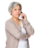 Asian senior woman use of mobile phone Stock Photography