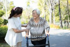 Free Asian Senior Woman Use Walking Aid During Rehabilitation,elderly People Encourage,assisting,care,support Her Best Friend Practice Stock Photography - 169185842