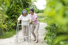 Free Asian Senior Woman Walk With Pian By Walker, She Living With Asian Female Physical Therapist Nurse Take Care Royalty Free Stock Photography - 192349037