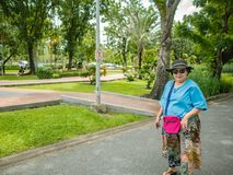 Portrait Photo of Asian Senior women walking in Chatuchak park Bangkok city. Asian Senior woman walking in Chatuchak park Bangkok city Thailand royalty free stock image
