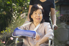 Asian senior woman on wheel chair Royalty Free Stock Image