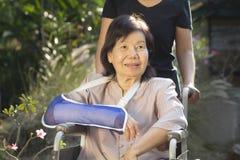 Asian senior woman on wheel chair Royalty Free Stock Image