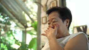Asian senior woman worry sigh thinking at home stock video footage